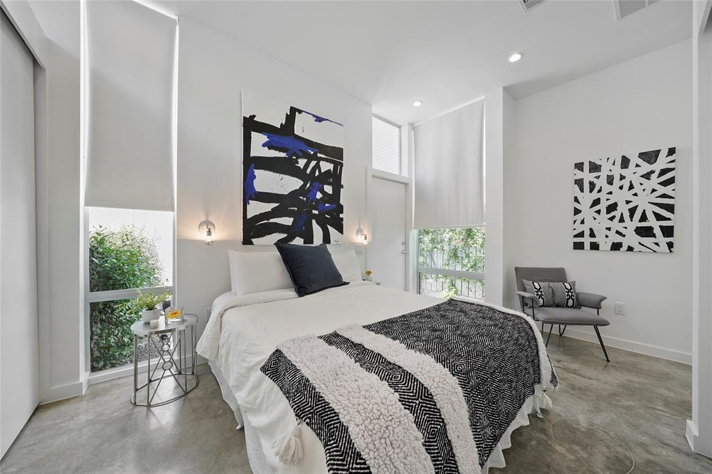 The master bedroom in the main suite features polished concrete floors and great closet space.