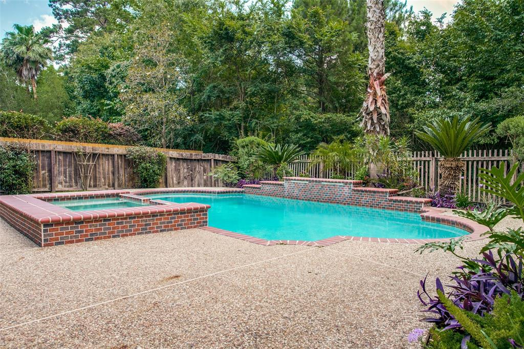 "TAKE TIME OUT FOR RELAXATION IN THE SWIMMING POOL OR IN THE HOT TUB at this well-maintained 4-bedroom/3 full bath home in The Woodlands Harper's Landing. NO BACK NEIGHBORS! This lovely home backs to a greenbelt for a little added privacy. Beautiful new vinyl plank wood floors extend from the foyer and into the living, kitchen, breakfast & the downstairs bedroom. The fully equipped island kitchen comes with Stainless appliances, 42"" beautiful cherry wood cabinets, Corian countertops & a breakfast bar. You will truly enjoy this open concept floorplan that allows for easy entertaining of family & friends.  The living area has a wall of windows to bring in the natural light! There is a guest bedroom downstairs with access to a full bathroom. The master suite, two other secondary bedrooms & a gameroom with French doors are on the 2nd floor.  You will also enjoy a covered patio and a full sprinkler system. Roof less than 1 yr old.  Hurry and buy now just in time for a 4th of July pool party."