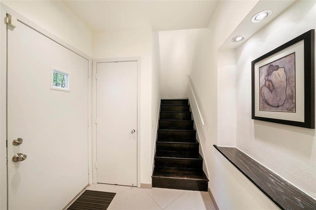 Front door entry leads to the hallway/bedrooms or up the stairs to the second floor living area.