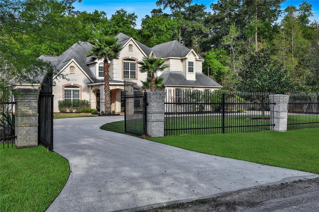 This stunning estate home is situated on just shy of 3/4 acres in the heart of The Woodlands with low taxes, low utilities and NO HOA FEES! Private, gated entrance leads to a circular driveway, extended parking and detached garage. As you step into this renovated home, take note of the open floorplan complete with formal dining, living, and spacious family room. The kitchen boasts an oversize island with extra seating, built-in stainless steel appliances and electric cooktop. Master retreat with large windows overlook the backyard. An en-suite master bath with His and Her sinks, jetted tub and separate walk-in shower. Take the stairs to the second floor gameroom and secondary bedrooms. Covered extended patio with a wooded and peaceful backyard. Great location close to The Woodlands amenities, I-45, shopping, dining & entertaining, yet private, country-like setting. Walking distance to Park and Ride, Playground and Gosling Sports Park.