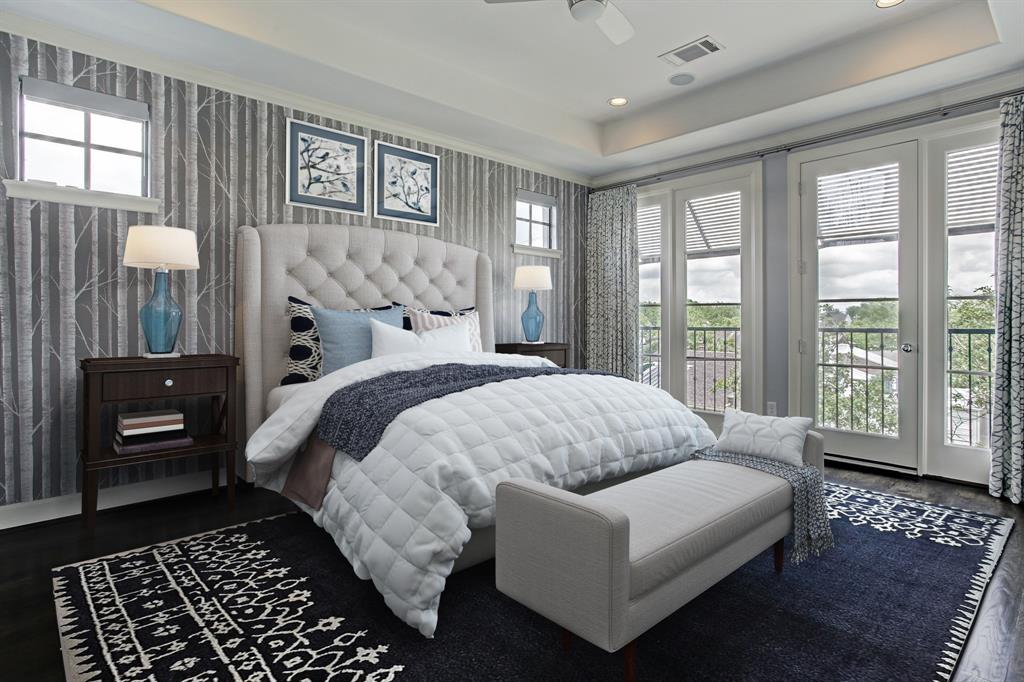 The master bedroom is finished in neutral hues, custom window treatments, and subtle wallpaper on the north wall.  This room has been virtually staged.