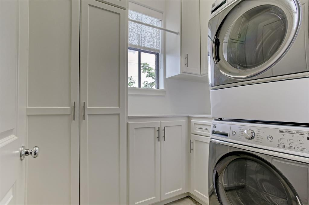 This true laundry room offers additional cabinet and storage space.  Washer and dryer are included.