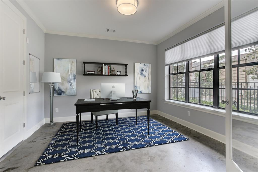 The first floor suite functions equally well as a bedroom or home office.  Door to the left is to the full bath with walk-in closet.  This room has been virtually staged.