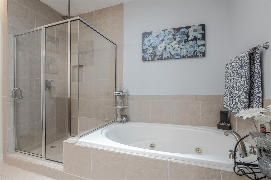 Master bath also features a jetted tub and large shower.