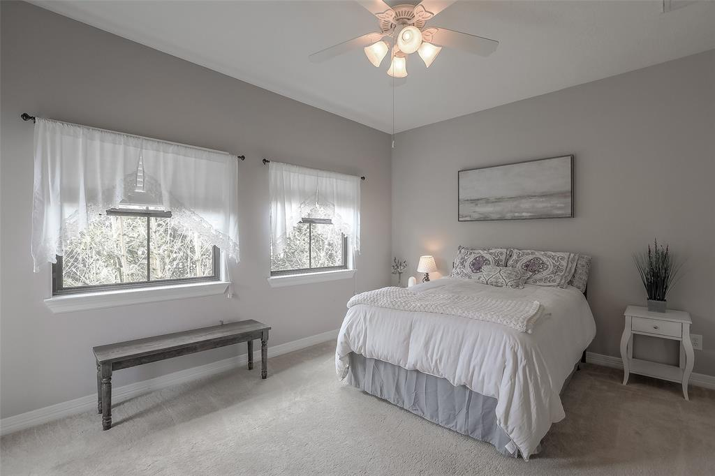 Spacious third bedroom with access to a private balcony.