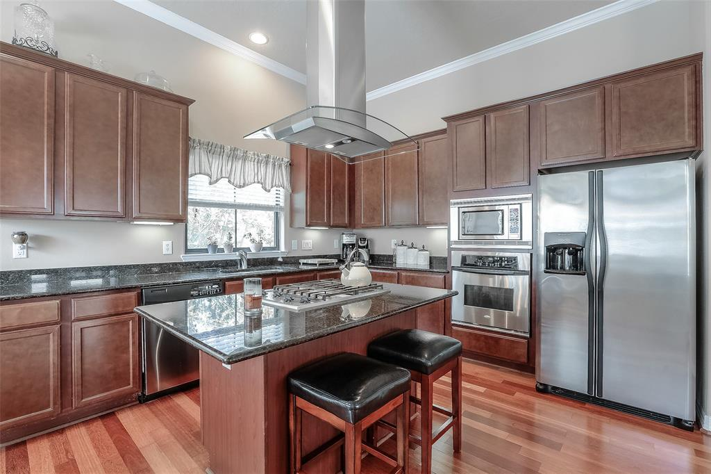 The center-island kitchen features granite counter tops, stainless steel appliances and lots of storage.