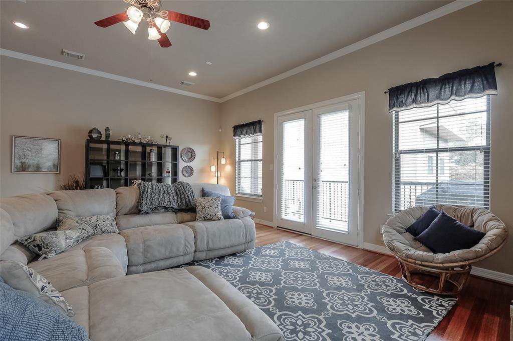 The living room also has access to one of three balconies.