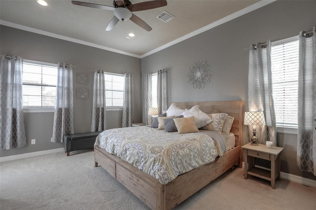 Luxurious master suite with great closet space, crown molding and balcony.