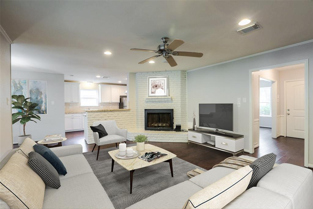 Large family room that's open to the kitchen and breakfast area. This image has been virtually staged.