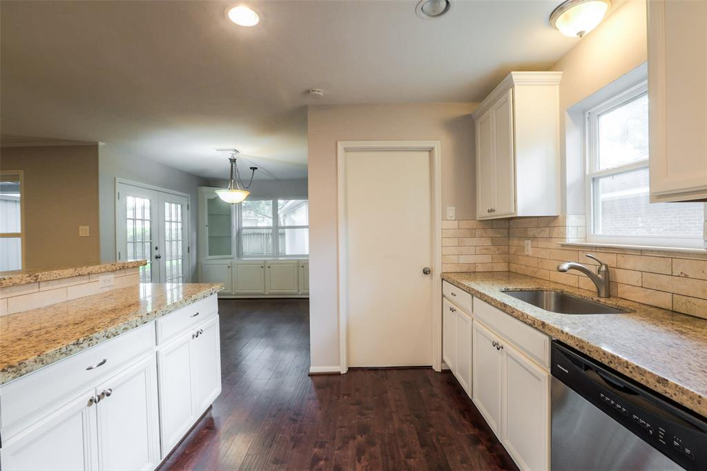 Updated kitchen features granite counter tops, stone back splash and stainless steel appliances.