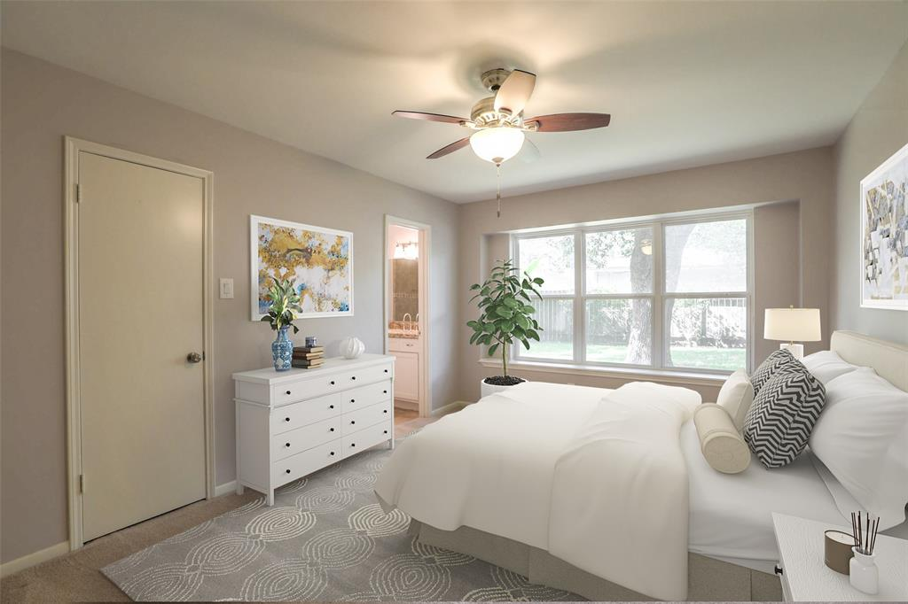 Master suite features a walk-in closet and updated bath. This image has been virtually staged.