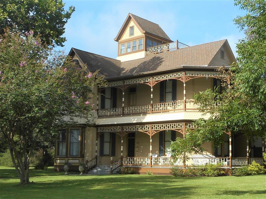 """This Queen Anne Victorian home was built in 1893. The home has 4,532 SF and is positioned on a 1/2 acre lot. Ask about adjacent corner 1/4 lot. 12"""" ceilings down. 11.5 ceilings upstairs. Original longleaf pine floors. Original wood windows. Owner NEVER painted longleaf pine wood trim. There is a master suite downstairs and upstairs, BOTH with private full bath and walk in closets. Third floor can be used as study, card room, and has room to add bath. 4th floor cupola is an amazing get a way above the tree line.  Full restoration completed in 2008, which included electrical, plumbing, rood, insulation, zoned heating and air conditioning. Main roof is Certainteed 50-year roof. Kitchen and porch roofs are standing seam metal. Mature Trees. Fenced with a well-constructed 7' high privacy fence. Sealy is located 30 minutes west of Katy on I-10. Sealy retains the small-town charm of yesterday, with historic downtown, and main street park, many churches, and recent fire station. Call today!"""