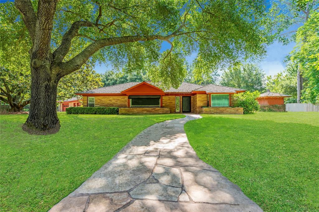 One of the most unique properties in all of the Houston area and a piece of Katy History! You will not believe the footprint of this Mid-Century Modern Home, sitting on an impressive 2 acres in Katy Proper! A coveted Mid-Century creation by famed architect, Wylie Vale! Listed on the National Registry of Historic Places. This unique home with huge basement, tunnel, and bank vault was damaged in Harvey - but can be remodeled & updated without losing NRHP status, or removed for new construction utilizing some custom materials from the original structure. The lot can be divided. There is great equity opportunity in the After Repair Value, but that's not why you'll want this home... it's the one of kind charm and incredible potential the property offers that will capture your heart & creative spirit! Located on Katy's most sought after tree-lined street, across from Katy HS, with easy access to I-10. You are going to love this very private, convenient and quiet neighborhood! Low Taxes Too!