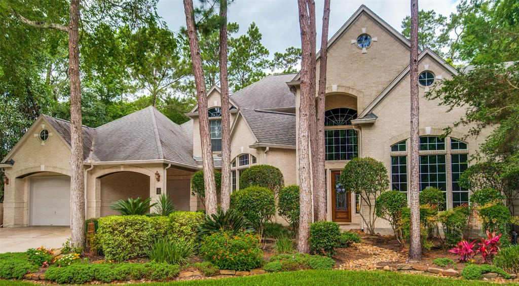 Incredible custom home in the prestigious Lyric Arbor neighborhood in The Woodlands. Fresh paint, beautiful wood floors, crown molding and high ceilings. Gorgeous scrolled custom spiral staircase in entry. Great kitchen with 5 burner gas stove, new stainless double ovens, under/over cabinet lighting, and butler's pantry/wet bar with cabinets. Breakfast area with built-in desk and cabinets. Open den with wall of windows, gas log fireplace and built-ins. Stunning views of pool and spa, beautifully landscaped yard and covered patio with ceiling fan. All bedrooms with walk-in closets, two bathrooms up. Master down with gorgeous remodeled bathroom, his and her closets with built in dressers. Great study downstairs with french doors and built-ins. Spacious gameroom up with four bedrooms, separate staircase and a Texas basement. Utility room down with sink and counters. 3 car tandem garage has epoxy floors and work station. Porte cochere for extra parking. A true custom home!