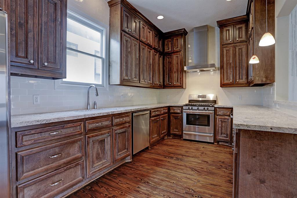 Stainless steel appliances include dishwasher, gas stove, vent hood and built in microwave