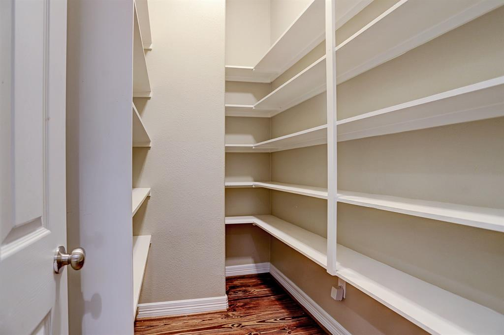 Amazing walk in pantry with tons of built in storage shelves
