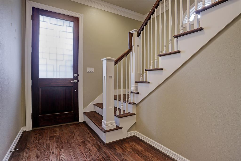 A grand staircase welcomes you when you walk in the door and leads up to the main living area on the second floor