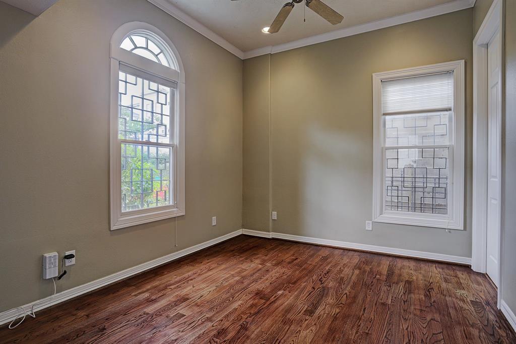 One of three bedrooms. Located on the bottom floor. Walk in closet and en suite bathroom.