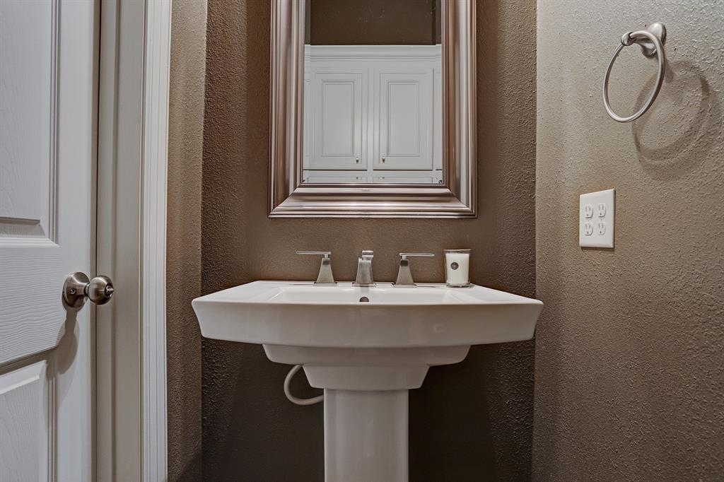 Half bath includes pedestal sink. Located off of the main living area on the second floor