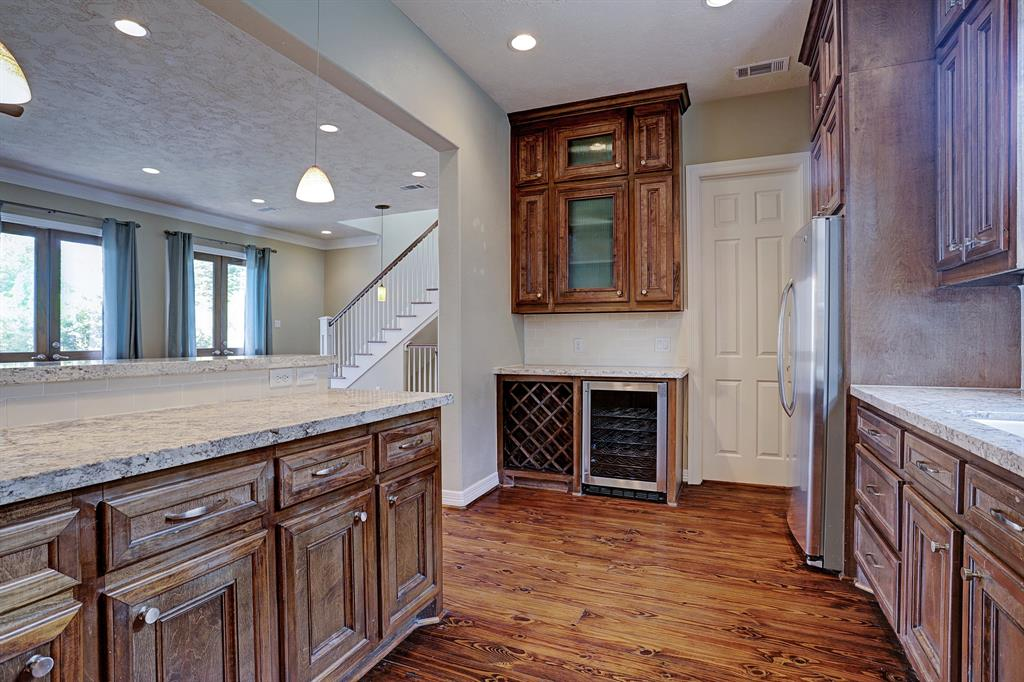Perfect for entertaining the kitchen opens up with a serving area to the living room. Wine storage and wine fridge make for the perfect bar setup