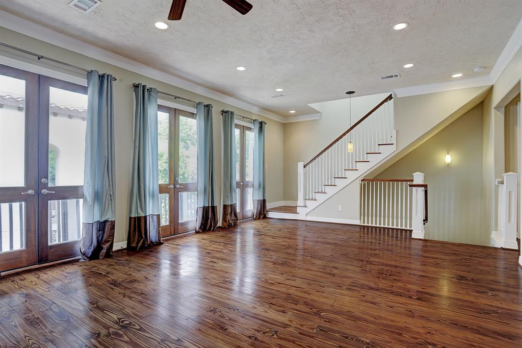 Large french doors doors lead out to a balcony off of the second story