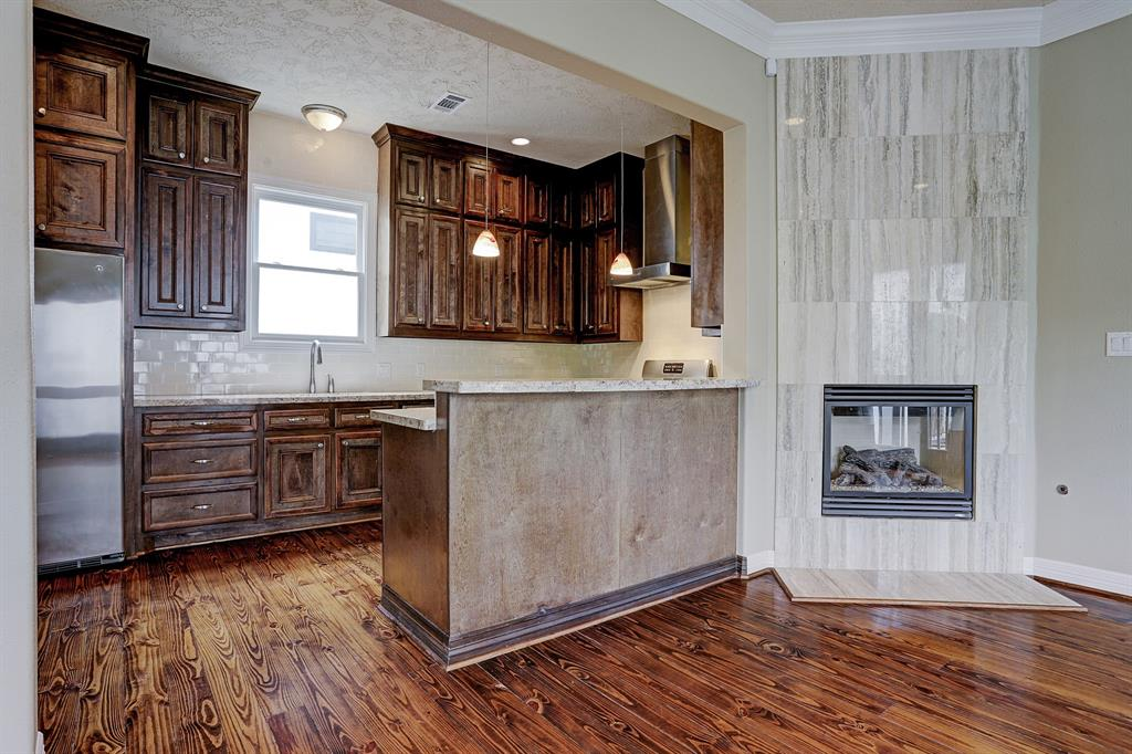 Beautiful wood cabinets provide lots of storage and go all the way to the ceiling