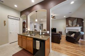 The kitchen flows well and offers a breakfast counter, granite counters, recent dishwasher, pantry and pendant lighting.