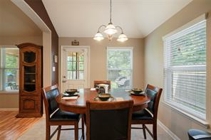 The breakfast area offers views into the backyard. Easy access to the patio for those chillin' and grillin' nights!