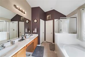 The master bath offers dual sinks, vanity, garden tub, large shower and huge walk-in closet.