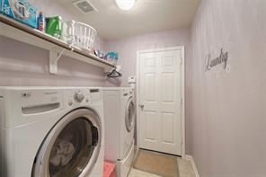 The utility room is located off the garage and is very spacious.