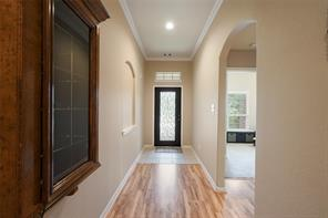 Entry into the home with beveled glass front door.