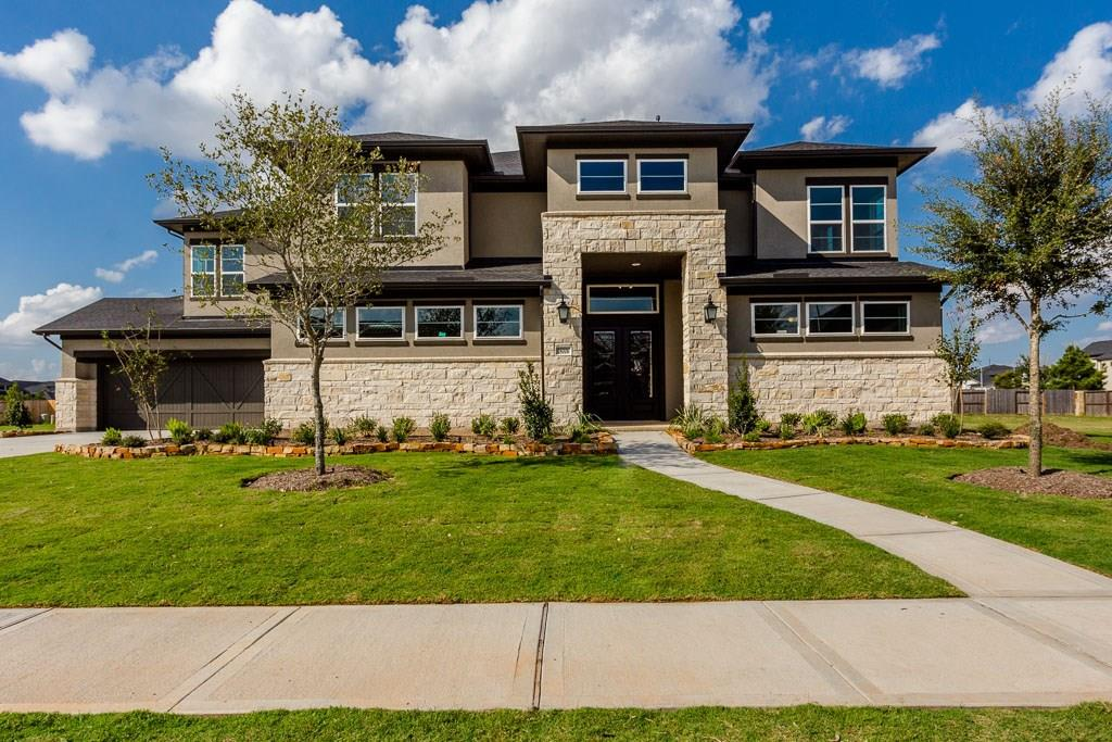 This stunning home has 5 bedrooms and 5.5 baths with a stone and brick exterior! You