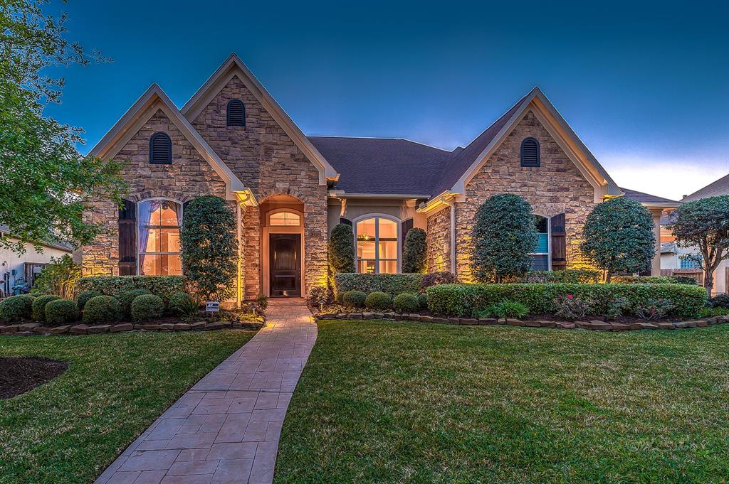 This 1-Story, 1-Owner custom showplace built by Ronny Carroll Homes is one not to miss. Superb location  on a large lot (no rear neighbors) in the exclusive gated Cinco Ranch community of Bayou Pines.  Endless list of top-of-the-line features in this sprawling floor plan incorporating a great room area & formal dining fit for entertaining - boasting all windows w/views leading to the pool & back yard.  Chef's kitchen w/huge island is surrounded by functional space, storage, features & stainless steel finishing touches.  Lavish Master Suite & spa-style master bath.  Private study w/a wall of built-ins. Expansive media room & 3 secondary bedrooms each w/ their own baths & in their own private areas of home. Two separate garages, covered veranda,  sparkling pool & massive yard.  Walking trail & community areas w/in this gated community & access to all the Cinco amenities, hike & bike trails. NO FLOODING!  Come make this yours!
