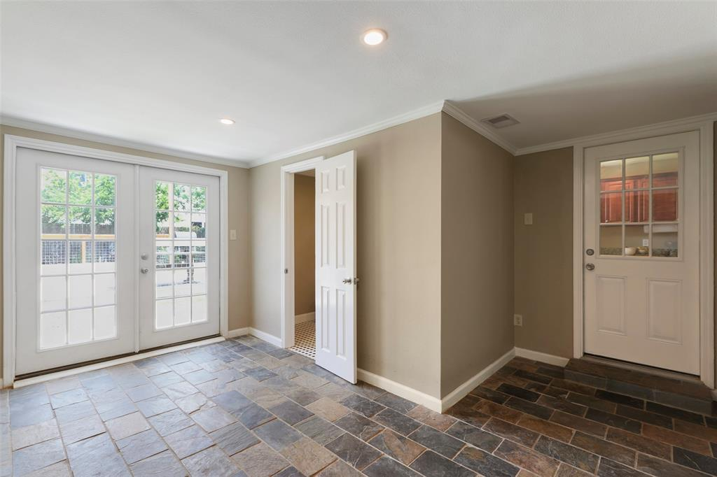 A VERY useful flex room with a full bathroom and french doors out to the back yard.