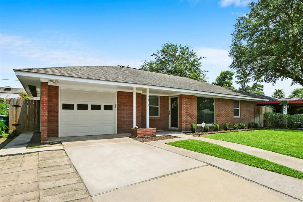 Nicely updated house with attached garage and double driveway! Big back yard on wooded lot with large, recently completed deck. Working sprinkler system in the front yard!