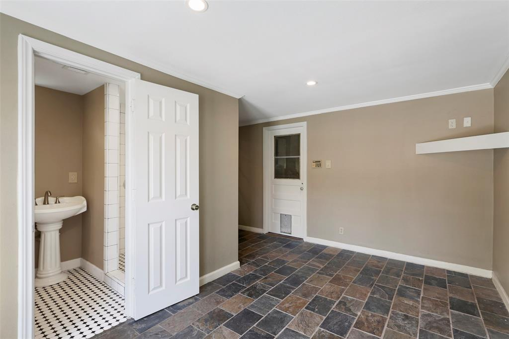 Flex area can be used as an office, gym, media room or even extra sleeping quarters. My clients used it as a gym. Leads to garage. Stylish bathroom which was added to the house in 2016.