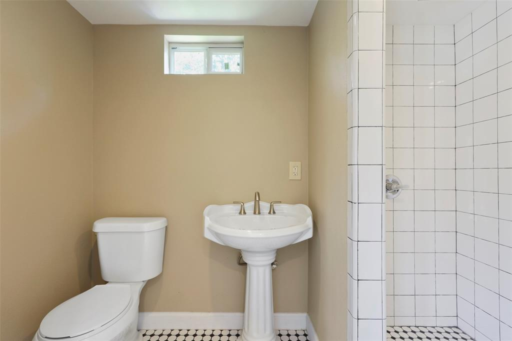 Attractive penny tile floors and walk in shower...
