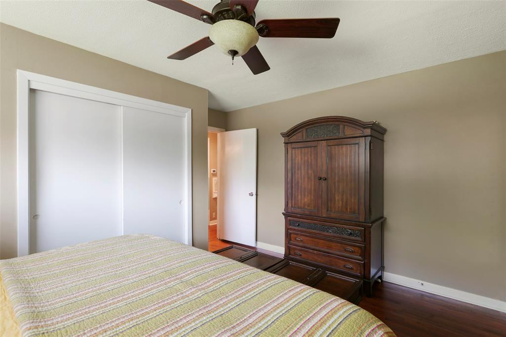 Master/primary bedroom with gorgeous wood flooring and ceiling fan on those hot summer nights.