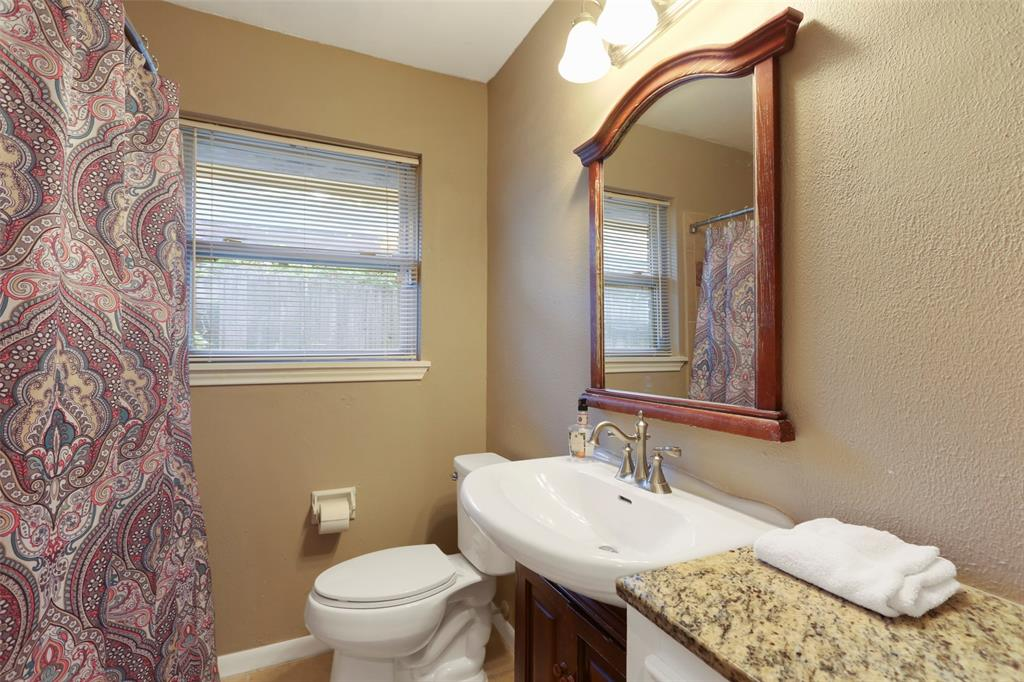 Hall bathroom is full bath with nicely updated fixtures & decor.