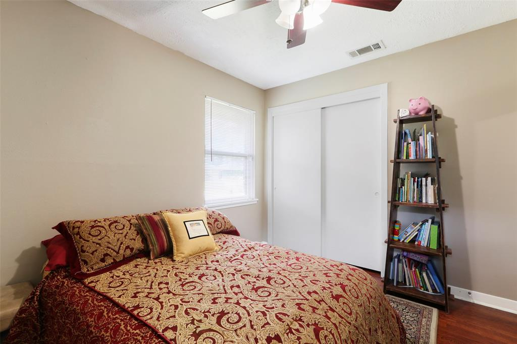 Third bedroom with ceiling fan is great as a bedroom or a useful office space.