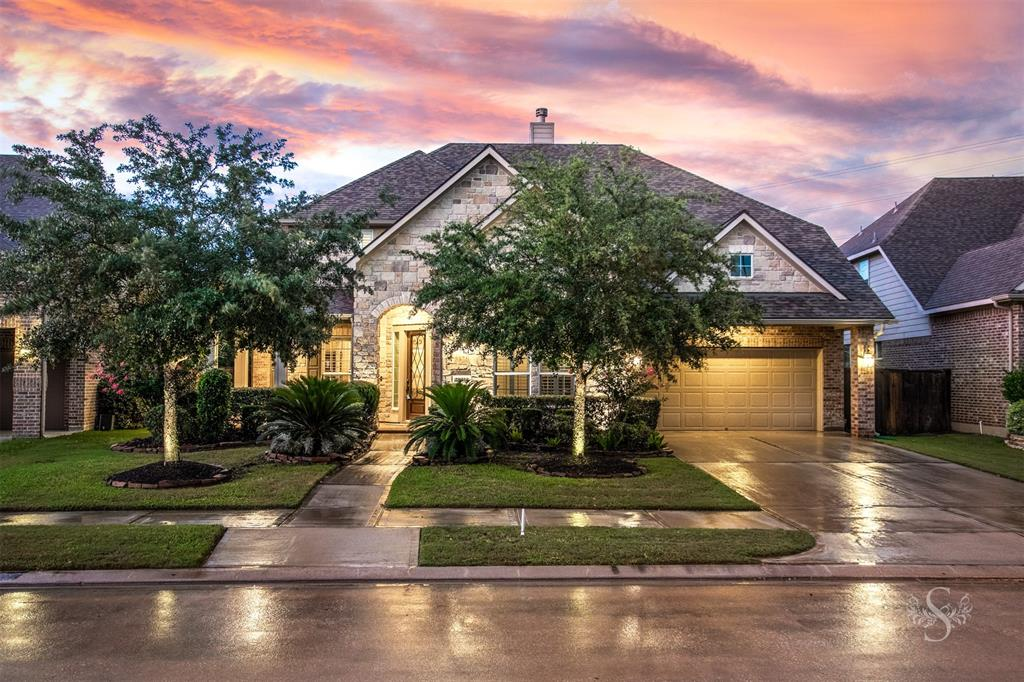 Gorgeous Village home in Cinco Ranch SW! This meticulously maintained beauty has 4 bedrooms, 3 full and 1 half bathrooms, and a pool and spa. Come inside to a soaring foyer and find your formal dining, with kitchen access, and an office with French doors. The living room has a floor to ceiling stacked stone fireplace, art niche, built-in entertainment center, recessed lighting, and pool views. The kitchen features granite counters, upgraded lights, stainless steel appliances, gorgeous tile backsplash, and center island. Your master bedroom also has pool views and a spa like master bath with dual sinks, makeup vanity, granite, and a walk in closet. Head upstairs for 3 additional bedrooms, 2 full bathrooms, a game room, and a media room. Outside is the perfect relaxing and entertaining space with an outdoor kitchen, covered patio, and a heated pool with a spa. Additional features included are water softener, security cameras, and a built-in study desk upstairs. Welcome home!