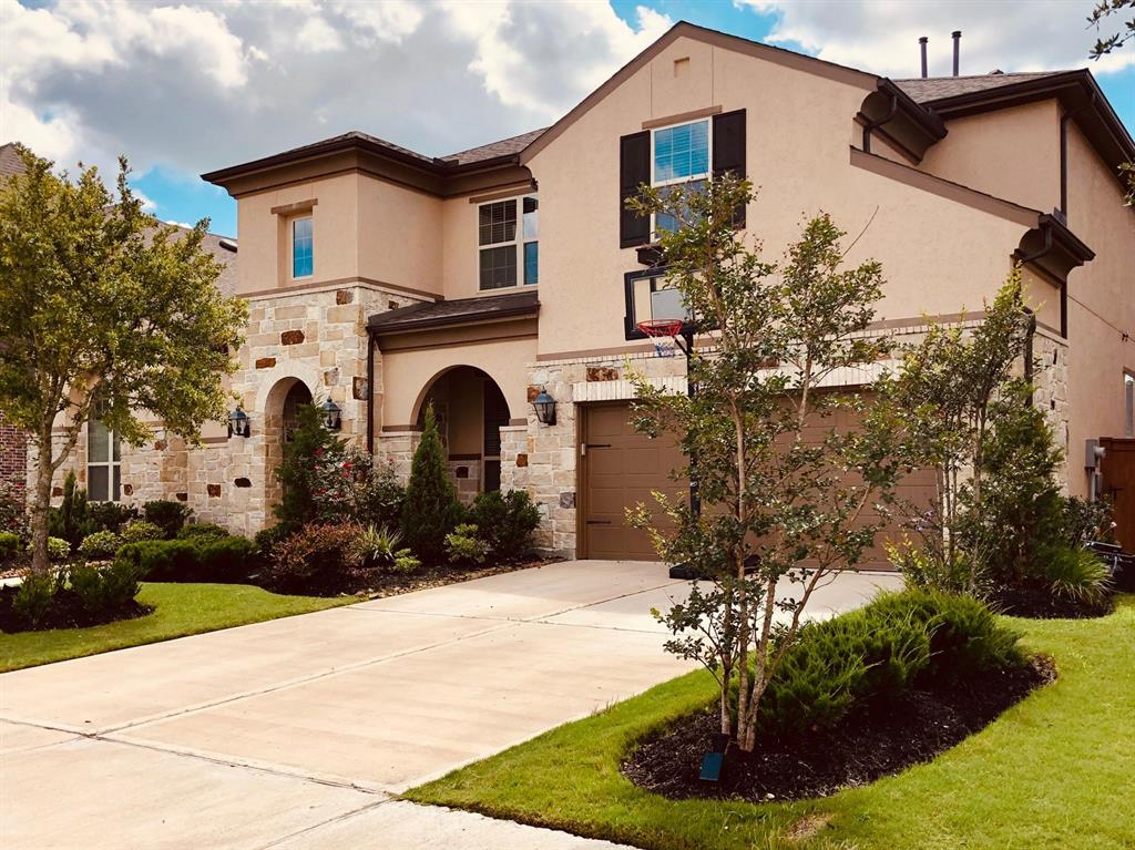 Highland homes exquisite 6 bed/4.5 bath home snuggled in a desirable Aliana subdivision. Exceptionally unique downstairs floorplan consists of 2 master suites, a guest room w/full attached bath/closet, a study/library, a formal dining w/butler's pantry, huge family room adjoined w/elegant gourmet kitchen & breakfast area, 4th bedroom converted to prayer room, half bath & an oversized utility room. Family area boasts soaring ceiling, elegant blanco/gray tiled floors & stone accented fireplace. The gourmet island kitchen has SS appliances, built-in microwave, dishwasher, double electric ovens, & a gas cook-top w/custom hood vent. The counter tops are beautiful granite accented by sparkling back-splash. A beautiful curved staircase w/custom metal spindles & wood railings leads to upstairs game room embraced w/2 separate nooks, a media room, a storage room & 2 bedrooms w/Jack & Jill bath. The massive covered patio w/brick arches & pillars overlooks the backyard w/plenty of green space.