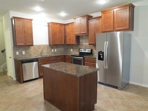 Kitchen features 42 in. Upper Cabinets with beautiful Auburn Maple finish