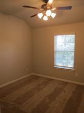 Secondary Bedroom Upstairs with Ceiling Fan and water view of Lake Conroe