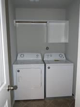 Washer and Dryer included. Built-In Shelf and Hanging Rod In Utility Room