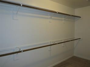 Additional Hanging Rods in this large Master Walk-In Closet