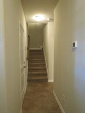 Central Hallway leads to Bedrooms upstairs and Kitchen/Breakfast