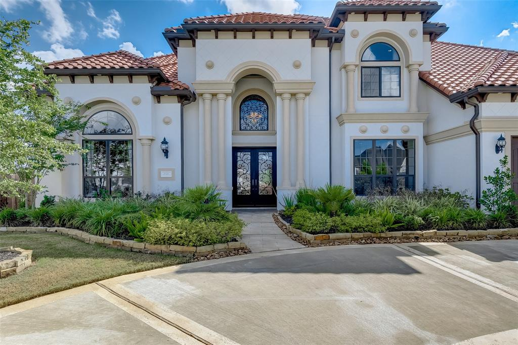 Custom 6 bed/6.5 bath Mediterranean home on 0.45 acre lot in Cinco Ranch's gated community. Master & 2 secondary beds on 1st floor! Pool Sized backyd w/ grand 2 story covered patio. Palatial Foyer is stunning with double leaded glass door & curved dual staircase. Wine grotto & a smart chef's kitchen boasts huge island/bar, JennAir Appliances, double oven, gas cooktop, custom granite, tile backsplash to name a few! Private Guest quarters on first floor w/ full bath. Private office with built-in storage & French doors. Spacious Mstr w on-suite, spa-like master bath!  Too many upgrades to list!  Come SEE!