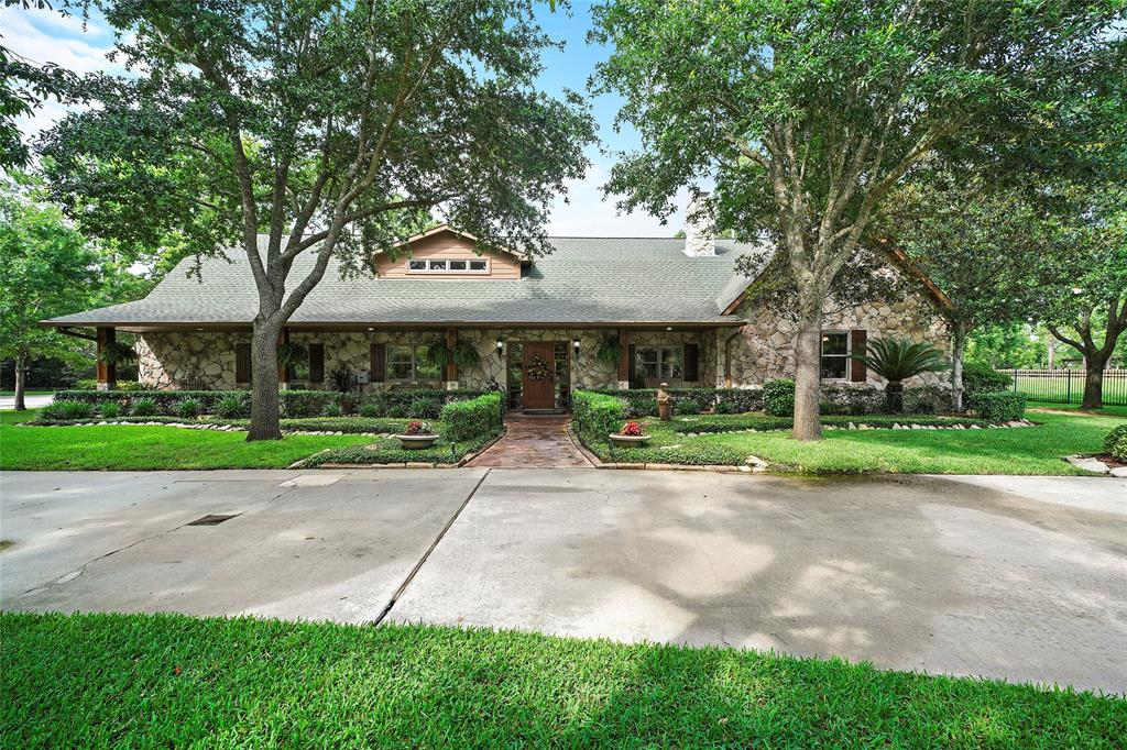 Come experience an incredible opportunity to own treed acreage in Friendswood. Enjoy the luxury of an acreage lifestyle with all the conveniences of city living. From the gated entry to the far back fence, this wonderful property provides unlimited possibilities. The home represents all that is Friendswood with family, friends and fun. It has wonderful heart-warming design with stone accents, a tall pine ceiling, three fireplaces and walls of built-ins. The custom kitchen by St. James includes two large islands, double dishwashers and Viking appliances. The home has two secondary bedrooms downstairs and two master suites. All the bedrooms have en-suite baths. Equally as wonderful as the livable interior is the outdoor area. The home's sheltered summer kitchen looks to a swimming pool, pool house, an RV storage building, the garage with an exercise room and open acreage to accommodate a baseball field. Unbelievable opportunities are available. Friendswood ISD