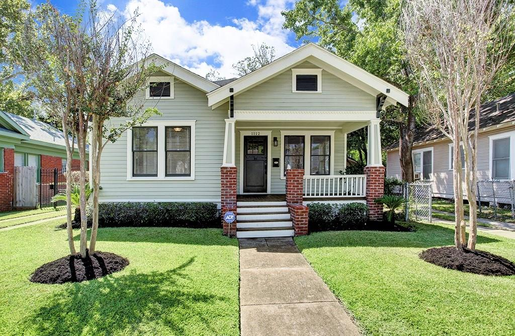 This darling, updated Norhill bungalow is the quintessential Heights home!